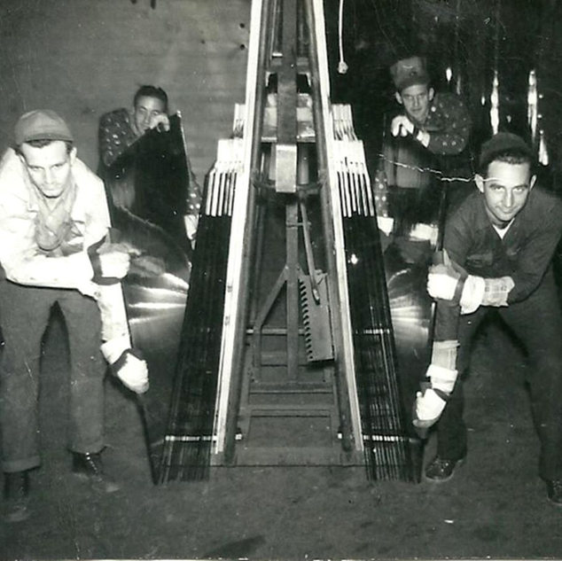 Rackman bringing sheets into cutters stall at Rolland glass ,Clarksburg.  Paul Mcvaney right front.