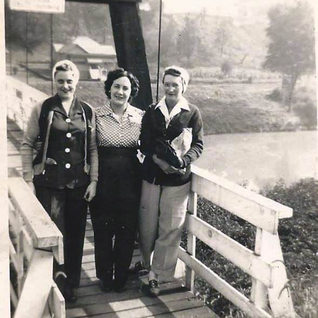 Ladies standing on the Adamston side of the swinging bridge over the West Fork.
