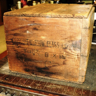 Wooden boxs for placing 90 lites of window glass of 8x10 size.  Box on display at the West Virginia Glass Museum Weston WV.