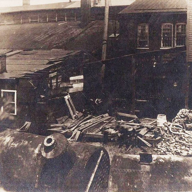 1907 photo shows the Cameron WV window glass plant after receiving damage from a railroad accident.