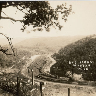 Around 1940 can be seen the remains of Royal Window Glass the last company to operate on this sight.  Three Fork creek has been moved further east along the hillside to make room for the B&O railroad yard.  The plant may have burned after 1923 by the look of debris.