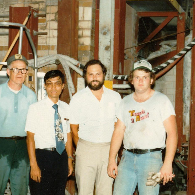 Photo at the old Adamston Flat Glass when Asahi glass company operated it in 1980-81.  Hordus Glass owned one year in 1979.  Pictured center Katsomoto Suzuki, my boss and Richard Duez, quality control.