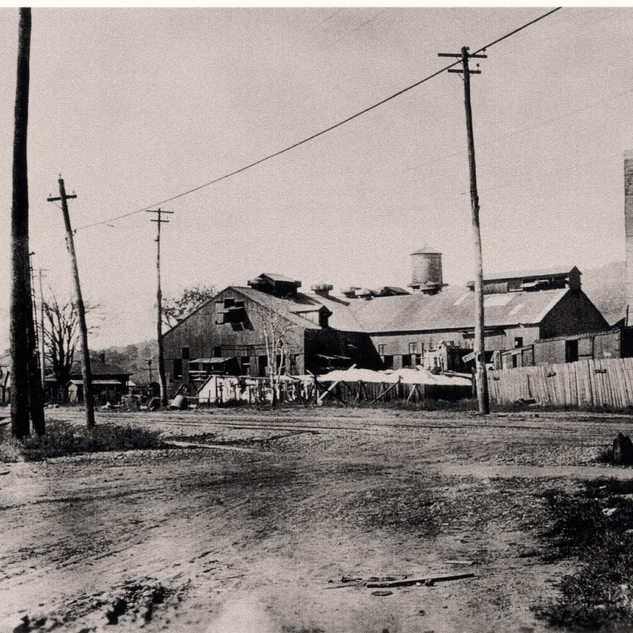 A view of Banner Window Glass Co. in South Charleston WV., operated by mostly Belgium's from 1907-20.  Note the dirt streets with street car tracks.