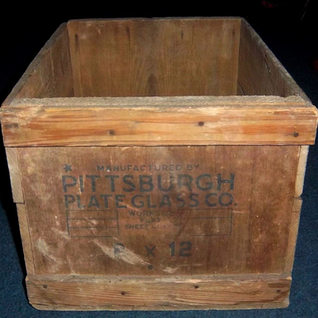 """This old wooden box once held around 80 lites of 8x12 single strength.  There were three ways to ensure delivery.  Straw was packed around the inside of the box in the early days.  Later thin sheets of paper were place betwee the lights by a """"paper boy"""" and by the 1970's wood dust was sprinkled over the glass."""