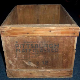 "This old wooden box once held around 80 lites of 8x12 single strength.  There were three ways to ensure delivery.  Straw was packed around the inside of the box in the early days.  Later thin sheets of paper were place betwee the lights by a ""paper boy"" and by the 1970's wood dust was sprinkled over the glass."