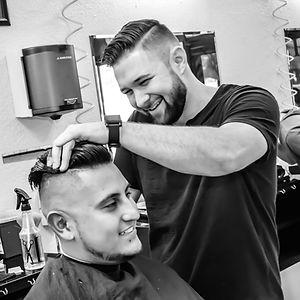 Barber cutting hair