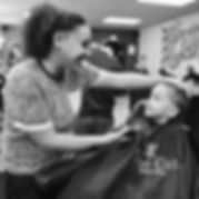female barber cutting hair