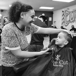 female barber cutting hair