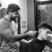 Barber cutting kids hair