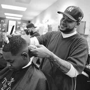 Barber shaving facial hair