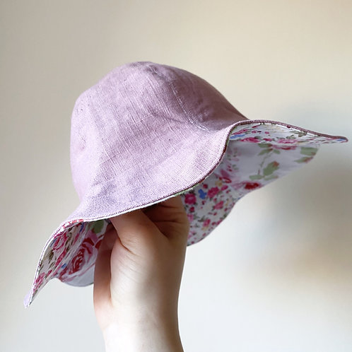 Handmade petal patchwork linen and cotton reversible sun hat in pink by little fig
