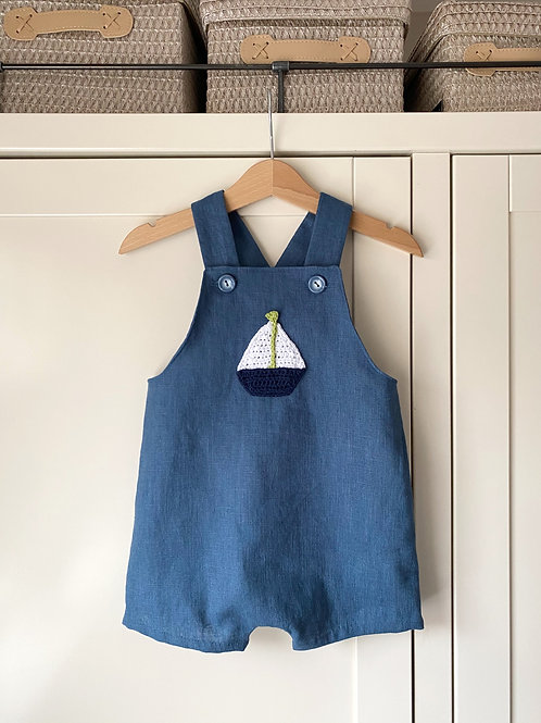Navy blue linen children's shortie dungarees with crochet boat motif by Little Fig