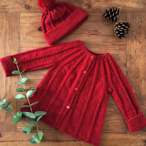 Knitted red baby coat and hat set with cable knit detail