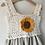 Close up of sunflower crochet motif and frill straps on linen children's summer dress by Little Fig