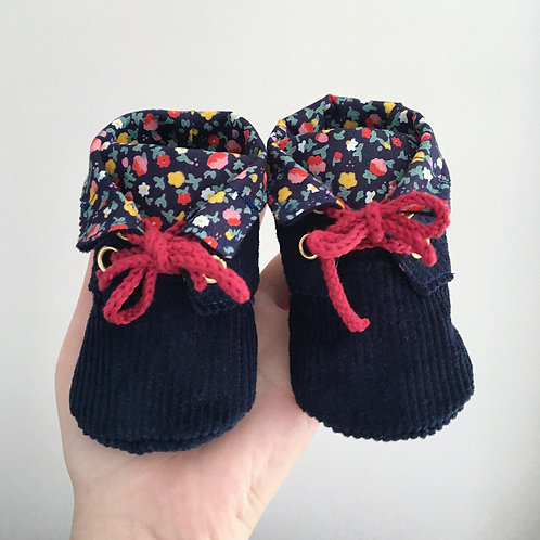 Front view of handmade navy corduroy baby boots with floral lining by Little Fig