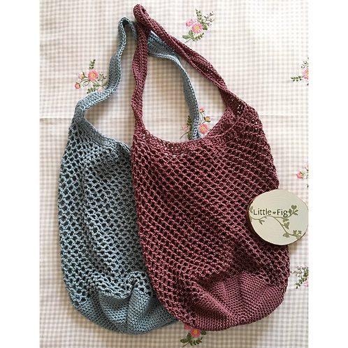 Handmade crochet shopping bag with long strap and circle bottom in sea green and wine by little fig