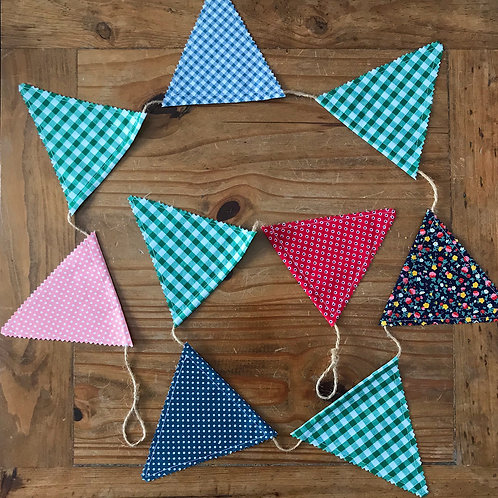 Medium size bunting in green blue red and pink patterned fabric