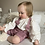 White gathered linen look cotton blouse with lavender bib shorts with bows on a child by Little Fig