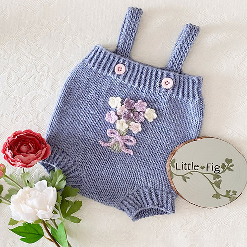 Handmade knitted purple floral baby romper shorts with crochet flowers by Little Fig