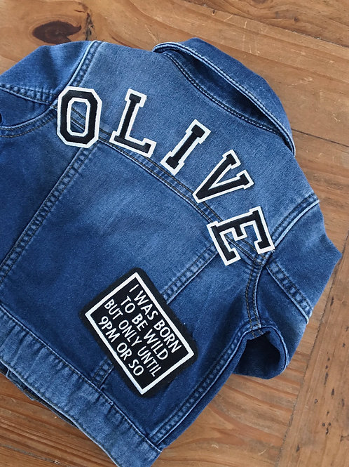 Back of upcycled denim kids jacket with name letter patch and word patch