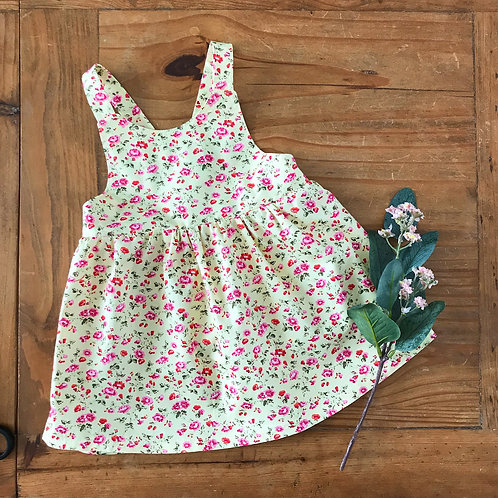 Cotton baby pinafore dress with pink and yellow floral print