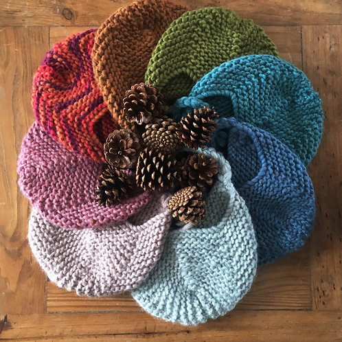 Handmade knitted baby aviator hats in a rainbow circle