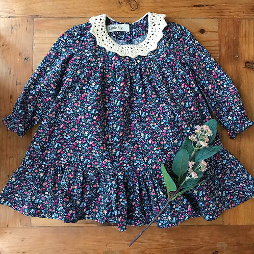 Blue ditzy print floral baby dress with crochet lace collar