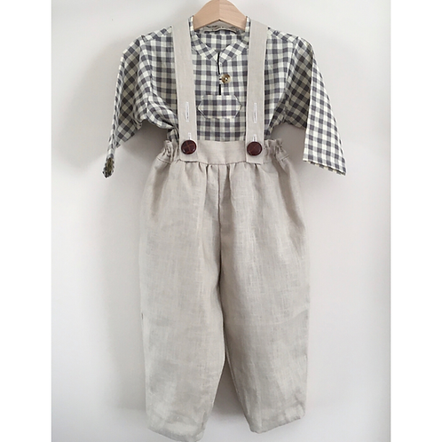 Beige linen baby trousers with brown leather style buttons and a grey check shirt