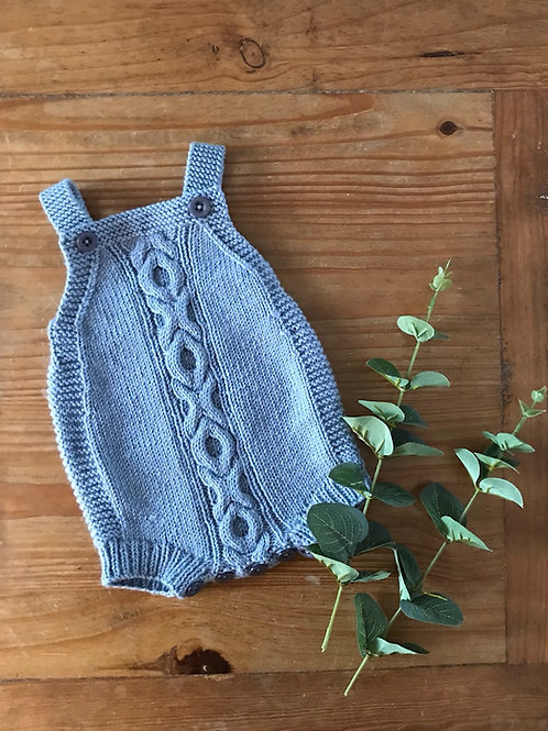 Blue cable knit baby romper with naught and cross details