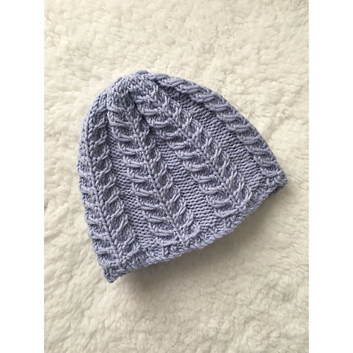 Knitted baby hat with feather cable detail in blue purple