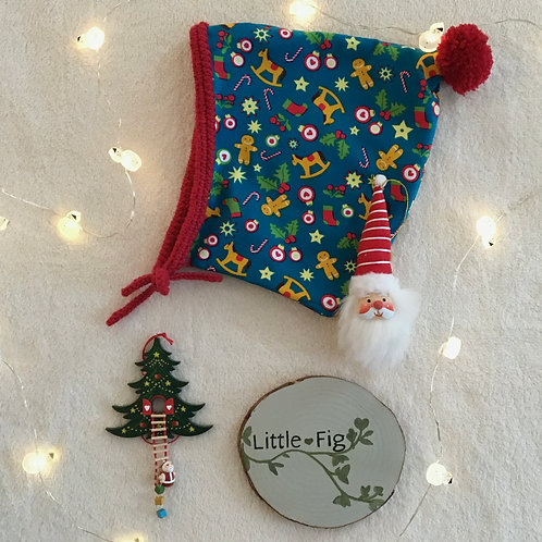 Oakley Cotton jersey pixie baby bonnet with Christmas gingerbread print by Little Fig