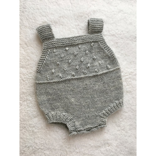 Handmade knitted romper with bobble stitch yoke bib