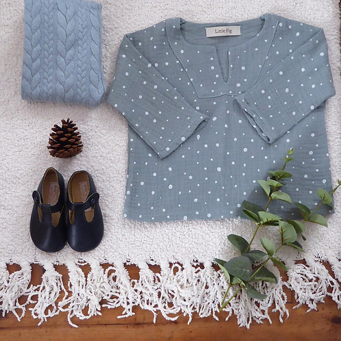 Blue smock top made from polka dot spot muslin fabric with blue cable leggings and navy shoes