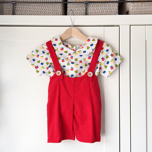 Handmade red corduroy bib shorts with wooden buttons and apple blouse by Little Fig