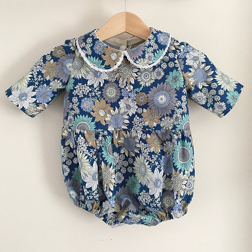 Blue floral baby romper with a peter pan collar with cotton lace detail