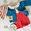 Handmade red corduroy bib shorts with wooden buttons, knitted cardigan, crochet hat and apple blouse by Little Fig