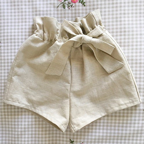 Handmade natural beige linen Ella paperbag childrens shorts with bow tie by Little Fig