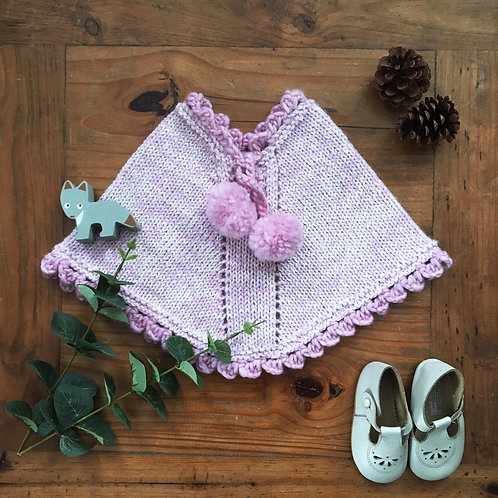 Pink scallop edge knitted baby poncho with large pink pom poms