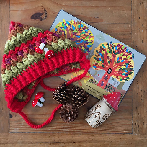 Striped crochet oversized children's Aspen bonnet by Little Fig in red, green and burgundy