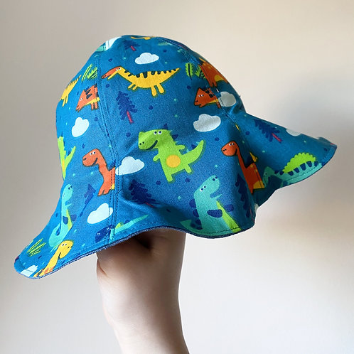 Handmade floppy sun hat in blue linen and turquoise dinosaur cotton by Little Fig