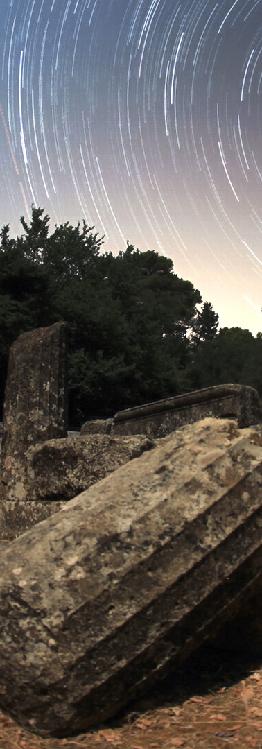 star trails over ancient temple