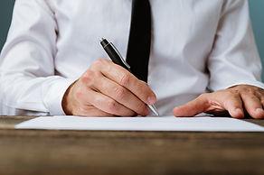 businessman-signing-a-contract-DA52VJX.jpg