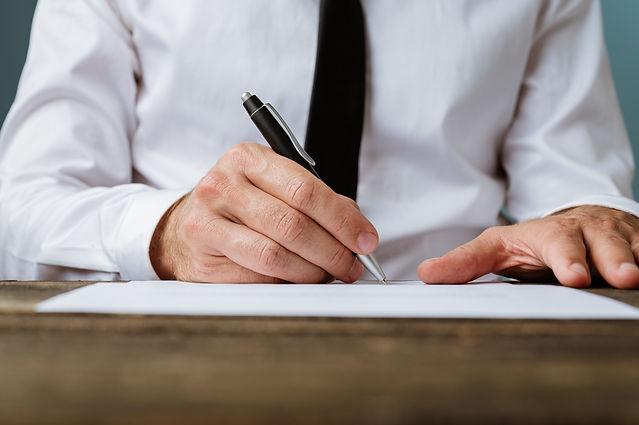 businessman-signing-a-contract-DA52VJX.j