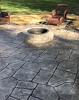 Stamped & colored concrete with firepit.