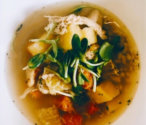 Roasted chicken and root vegetables soup