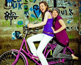 girls having fun on a bicycle