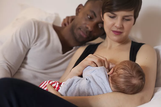 happy-young-parents--mother-is-breastfee