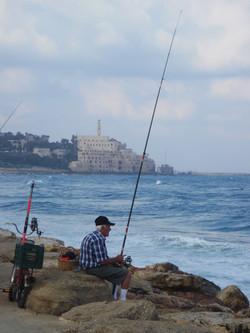 Fisherman on Tel Aviv promenade