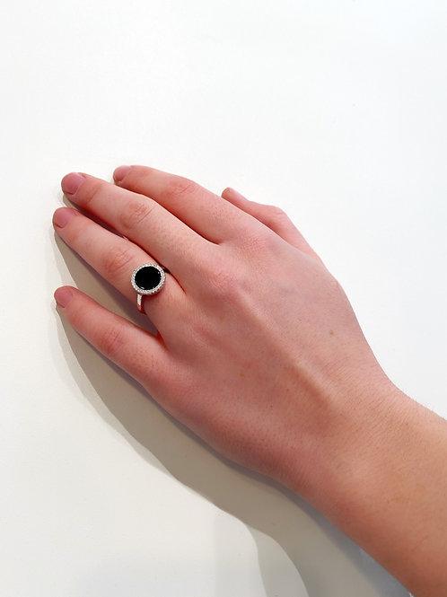 Anello pietra nera tonda con zirconi