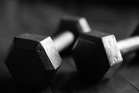 Dumbbell weights sitting on floor.